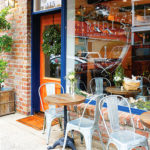 rudi's-old-village-wine-shop-storefront-cafe-chairs
